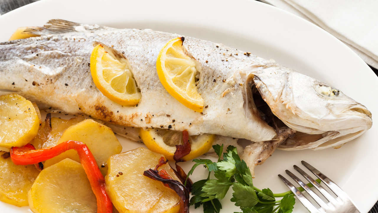 BAKED SEA BASS WITH SLICED POTATOES