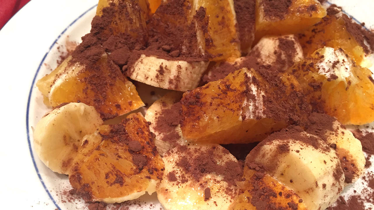 Orange and banana with almonds and cocoa powder