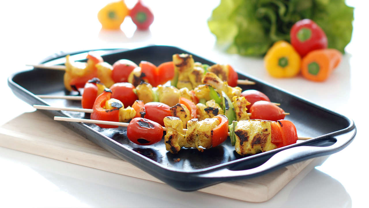 Chicken skewers and cherry tomatoes with basil