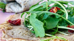 Saracen wheat crepes stuffed with arugula and avocado