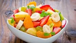 Fruit salad with papaya, banana and blueberries