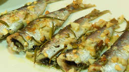 Baked or grilled sardines with garlic and parsley